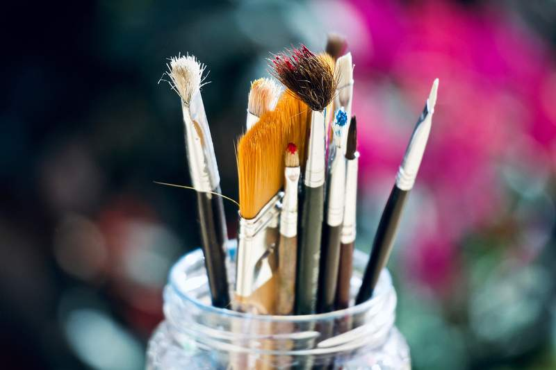 Paintbrushes in a jar.