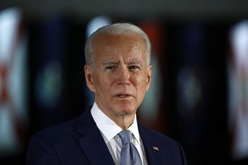 """FILE - In this March 10, 2020, file photo Democratic presidential candidate former Vice President Joe Biden speaks to members of the press at the National Constitution Center in Philadelphia. Biden said Friday, May 29, that the """"open wound of systemic racism was behind the police killing of a handcuffed black man in Minnesota, and swiped at President Donald Trump for inciting violence, without mentioning him by name. """"We are a country with an open wound. None of us can turn away, Biden in a brief online address. (AP Photo/Matt Rourke, File)"""