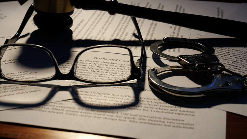 Court documents, glasses and a judge's gavel