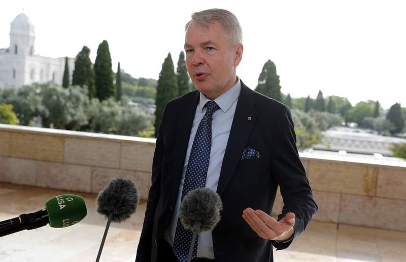 FILE - In this Thursday, May 27, 2021 file photo, Finland's Foreign Minister Pekka Haavisto speaks with the media in Lisbon. A European Union envoy says Ethiopias leaders told him in closed-door talks earlier this year that they are going to wipe out the Tigrayans for 100 years. The envoy, Pekka Haavisto, Finland's foreign minister, says such an aim looks for us like ethnic cleansing. Haavisto spoke in a question-and-answer session Tuesday, June 15 with a European Parliament committee. (AP Photo/Armando Franca, file)