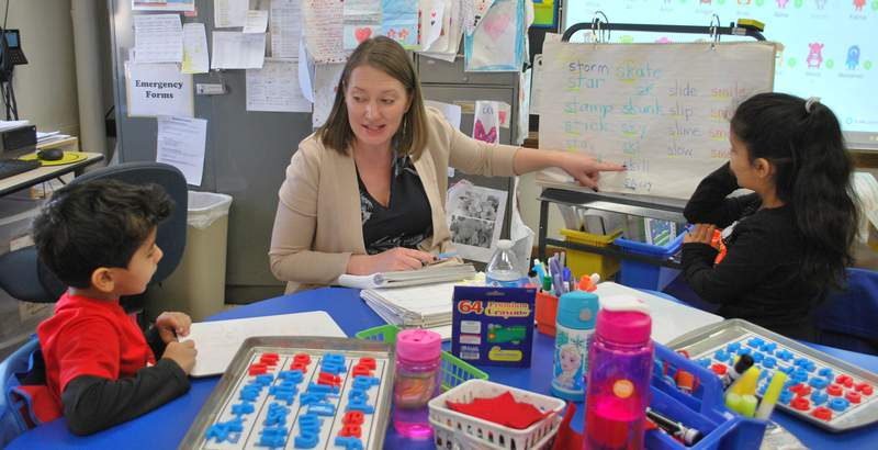 Another teacher assists with small group instruction in a second grade classoom at Maples Elementary.  Dearborn Schools has designated teachers that visit classrooms and help the homeroom teacher provide additional small group instruction.  Maples was recently recognized as a national Distinguished School for its success in helping at-risk students succeed.  Photo Dec. 5, 2018