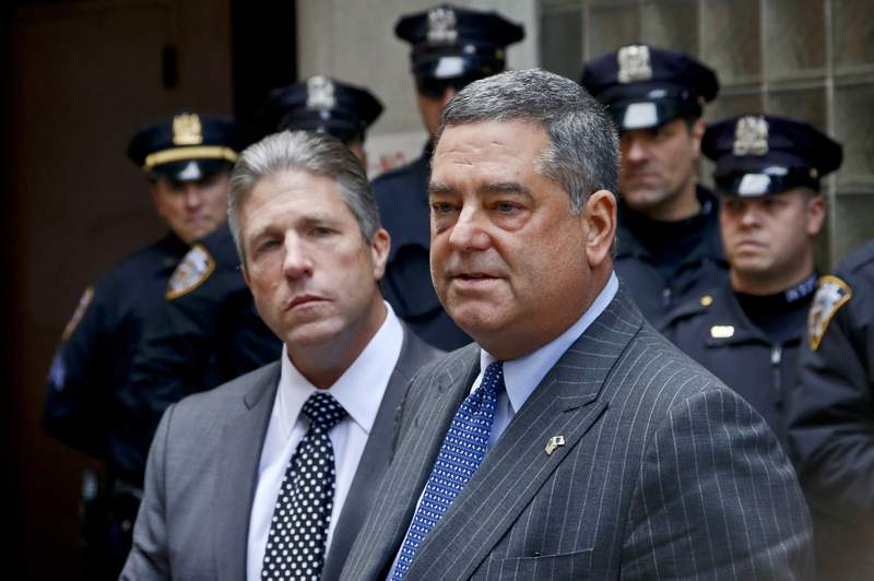 FILE  In this Oct. 28, 2016 file photo, President of the Patrolmen's Benevolent Association Patrick Lynch, left, and New York City Police Department's Deputy Commissioner for Legal Matters Lawrence Byrne hold a press conference after addressing the parole hearing for the four men convected in 1988 killing of NYPD Officer Edward Byrne, in New York. Byrne, the NYPD's top lawyer during a fraught period that followed a court ban on officers frisking people without cause, the chokehold death of Eric Garner and the revelation that police spied on law-abiding Muslims after 9/11, has died. He was 61. (AP Photo/Bebeto Matthews, File)