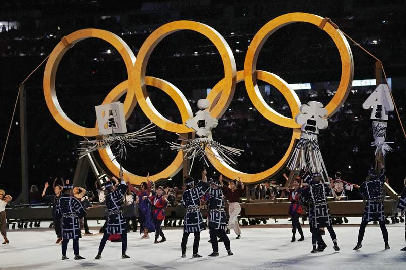 Dancers perform during the opening ceremony in the Olympic Stadium at the 2020 Summer Olympics, Friday, July 23, 2021, in Tokyo, Japan. (AP Photo/Petr David Josek)