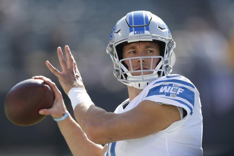 FILE - In this Nov. 3, 2019, file photo, Detroit Lions quarterback Matthew Stafford warms up before an NFL football game against the Oakland Raiders in Oakland, Calif. Since the start of last year, Matthew Stafford has had to deal with a health scare involving his wife, his own injury problems -- and more recently, a coronavirus test that the team later described as a false positive. It's been a difficult period for the Detroit star. (AP Photo/D. Ross Cameron, File)