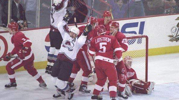 17 May 1997: Right wing Claude Lemieux, left wing Waleri Kamensky of the Colorado Avalanche celebrate during a playoff game against the Detroit Red wings at the McNichols Arena in Denver, Colorado. The Red wings won the game 4-2. Mandatory Credit: Jed J