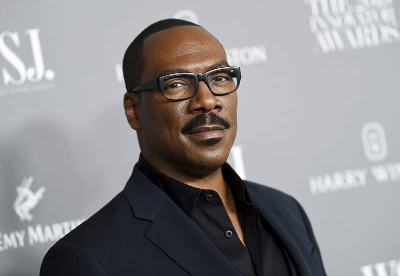 FILE - Honoree actor-comedian Eddie Murphy attends the WSJ. Magazine 2019 Innovator Awards in New York on Nov. 6, 2019. Coming 2 America, the sequel to the 1988 Eddie Murphy comedy, has landed on a date to come to audiences. Amazon Studios announced Friday that the film which reunites Murphy and Arsenio Hall will debut on Amazon Prime Video on March 5, 2021.  (Photo by Evan Agostini/Invision/AP, File)