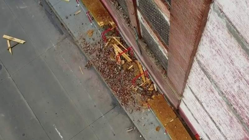 Debris falling from deteriorating Detroit building closes road on city's east side