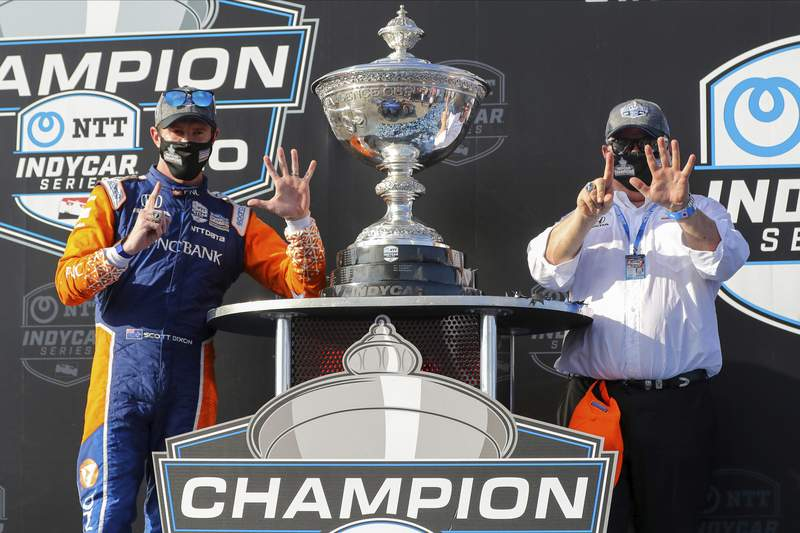 FILE - Driver Scott Dixon, left, and team owner Chip Ganassi celebrate after winning the NTT IndyCar Series Championship following an IndyCar auto race in St. Petersburg, Fla., in this Sunday, Oct. 25, 2020, file photo. The upcoming IndyCar season will be headlined by the six-time IndyCar champion. (AP Photo/Mike Carlson, File)