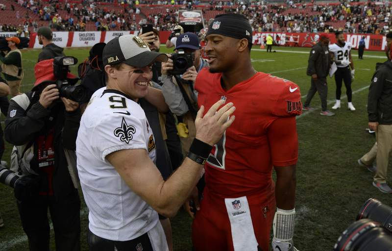 FILE - In this Dec. 9, 2018, file photo, New Orleans Saints quarterback Drew Brees (9) shakes hands with Tampa Bay Buccaneers quarterback Jameis Winston (3) after an NFL football game in Tampa, Fla.  Brees, the NFLs leader in career completions and yards passing, has decided to retire after 20 NFL seasons, including his last 15 with New Orleans.(AP Photo/Jason Behnken, File)