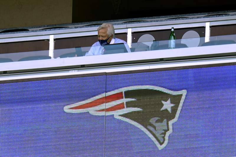 New England Patriots owner Robert Kraft wears a mask as he sits alone in his box in the first half of an NFL football game against the Miami Dolphins during the coronavirus pandemic, Sunday, Sept. 13, 2020, in Foxborough, Mass. (AP Photo/Charles Krupa)