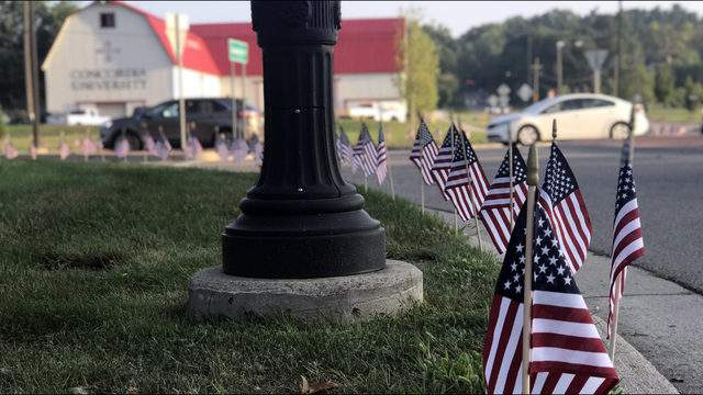 Flags planted by Concordia University students line the Geddes Road roundabout on Sept. 11, 2019. (Credit: Meredith Bruckner)