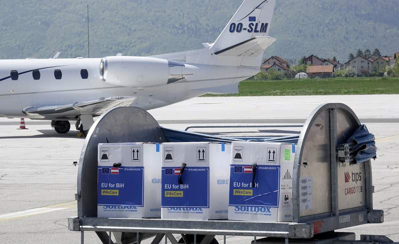 FILE - In this May 4, 2021, file photo, a container with boxes of the Pfizer vaccine for COVID-19 is delivered at the Sarajevo Airport, Bosnia. The head of the World Trade Organization said Friday, May 7, the U.S. administrations call to remove patent protections on COVID-19 vaccines could help expand fair access to vaccines but might not be the most critical issue, as officials in Europe increasingly insisted that more vaccine exports are the more pressing priority. (AP Photo/Eldar Emric, File)