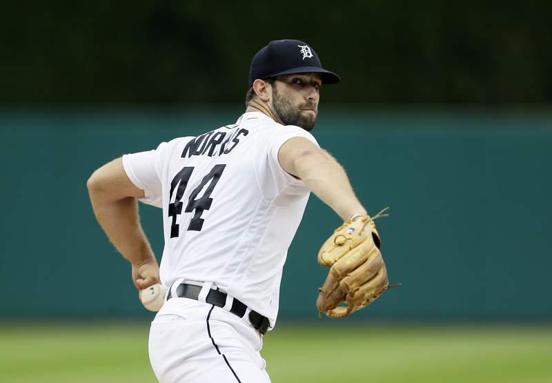 Daniel Norris #44 of the Detroit Tigers takes a warmup pitch against the Chicago White Sox during game one of a doubleheader at Comerica Park on August 6, 2019 in Detroit, Michigan.