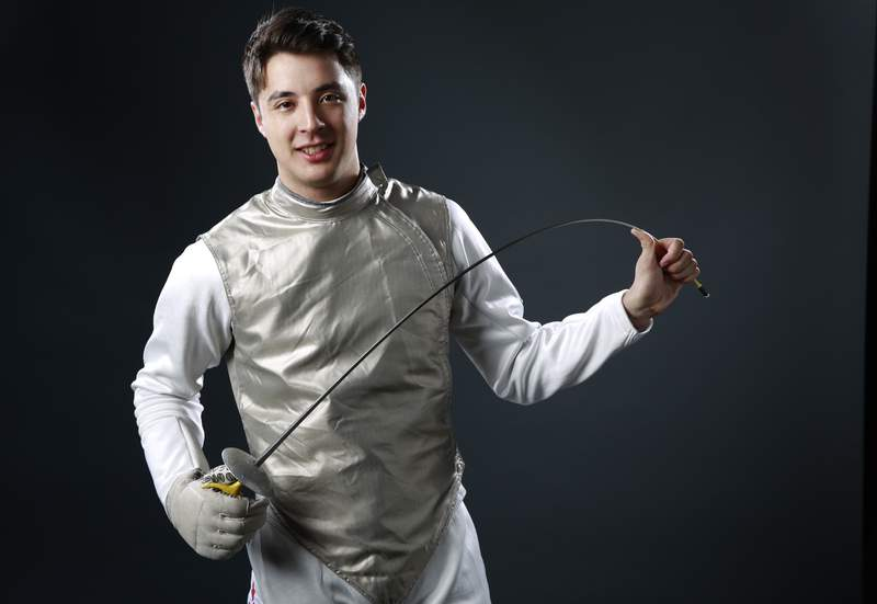 FILE - In this March 9, 2016, file photo, Olympic fencer Alex Massialas poses at the 2016 Team USA Media Summit in Beverly Hills, Calif. If all the athletes from Stanford had been their own country, they would have tied for 11th place in the medal standings at the 2016 Olympics. Its an eye-opening statistic that has been made more jarring because of the recent decision by Stanford to remove nine Olympic sports from its varsity program.  (AP Photo/Damian Dovarganes, File)