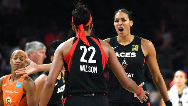 LAS VEGAS, NEVADA - JUNE 02: Liz Cambage #8 and A'ja Wilson #22 of the Las Vegas Aces celebrate on the court after Cambage scored against the Connecticut Sun during their game at the Mandalay Bay Events Center on June 2, 2019 in Las Vegas, Nevada. The Sun defeated the Aces 80-74. (Photo by Ethan Miller/Getty Images )