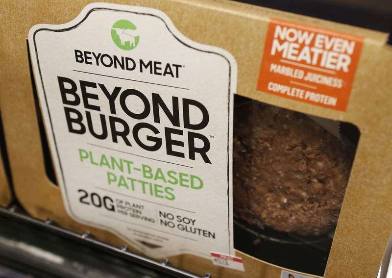 FILE - In this June 27, 2019, file photo a meatless burger patty called Beyond Burger made by Beyond Meat is displayed at a grocery store in Richmond, Va. Beyond Meat said Monday, Nov. 9, 2020 that it felt the full force of the coronavirus pandemic in the third quarter, leading to worse-than-expected financial results. Consumer stockpiling in the second quarter, coupled with continuing struggles at restaurants and other food service customers, made demand unpredictable, the company said. AP Photo/Steve Helber, File)