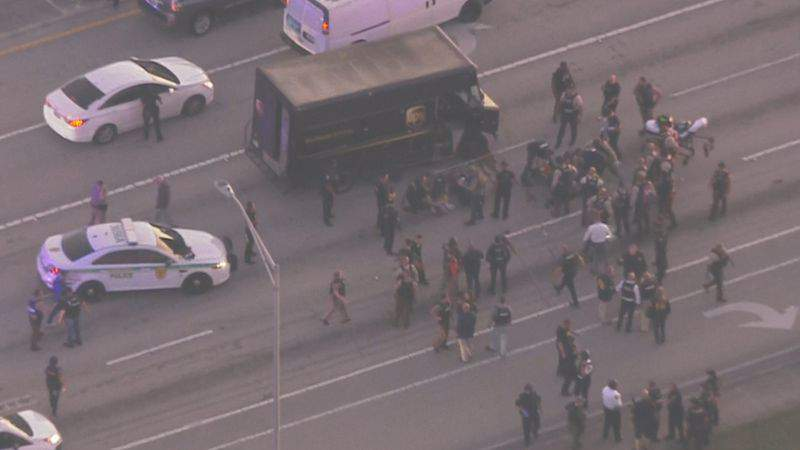 Police surrounds UPS truck after pursuit ends in gunfire in South Florida. (Image: WPLG)