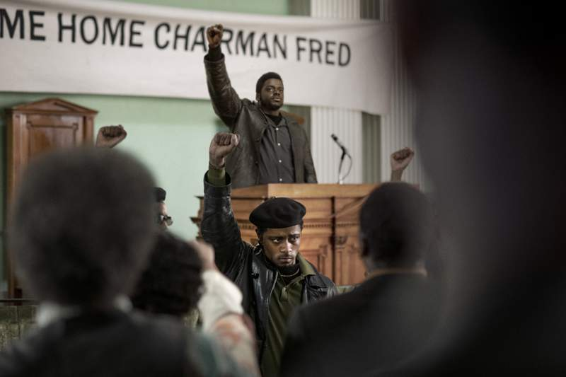 """This image released by Warner Bros. Pictures shows LaKeith Stanfield, foreground, and Daniel Kaluuya in a scene from the upcoming film """"Judas and the Black Messiah.""""   The Ryan Coogler-produced Fred Hampton film will have its premiere at the Sundance Film Festival before heading to HBO Max and theaters, programmers announced Tuesday. Daniel Kaluuya plays the Black Panther Party chairman and his Get Out co-star Lakeith Stanfield plays FBI Informant William ONeill who agrees to infiltrate the group in the late 1960s. (Glen Wilson/Warner Bros. Entertainment via AP)"""