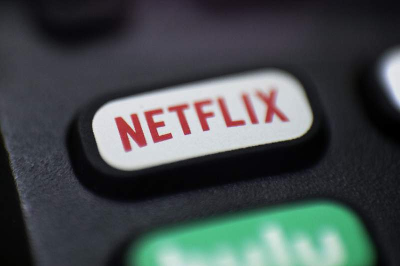 FILE - This Aug. 13, 2020, file photo shows a logo for Netflix on a remote control in Portland, Ore. Netflixs video streaming service has surpassed 200 million subscribers for the first time as its expanding line-up of TV series and movies continues to captivate people stuck at home during the ongoing battle against the pandemic. The subscriber milestone highlighted Netflixs fourth-quarter results released Tuesday, Jan. 19, 2021. (AP Photo/Jenny Kane, File)