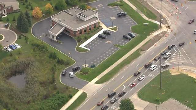 A suspect reportedly was on foot Sept. 15, 2017 after a robbery at a bank near Haggerty and Maple roads. (WDIV)