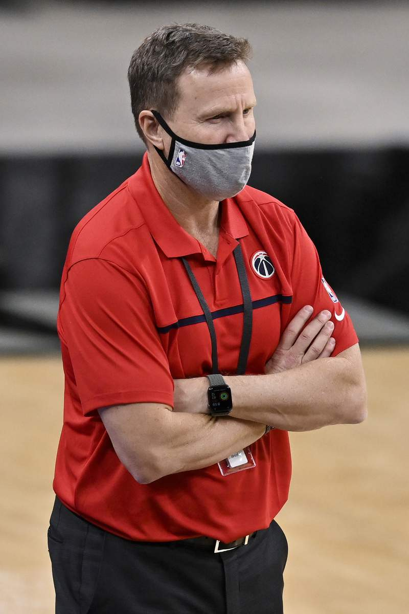 Washington Wizards head coach Scott Brooks watches play during the second half of an NBA basketball game against the San Antonio Spurs, Sunday, Jan. 24, 2021, in San Antonio. San Antonio won 121-101. (AP Photo/Darren Abate)
