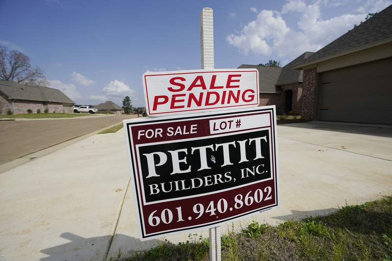 """A """"Sale Pending"""" sign stands along side a new driveway in Madison County, Miss., Tuesday, March 16, 2021.  U.S. home prices increased at the fastest pace in seven years in January as the pandemic has fueled demand for single-family houses even as the supply for such homes shrinks. The S&P CoreLogic Case-Shiller 20-city home price index, released Tuesday, March 20, rose 11.1% in January from a year earlier.  (AP Photo/Rogelio V. Solis)"""