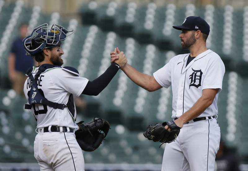 Detroit Tigers reliever Michael Fulmer, right, celebrates with catcher Eric Haase after a 5-3 win over the Chicago White Sox in a baseball game Tuesday, Sept. 21, 2021, in Detroit.