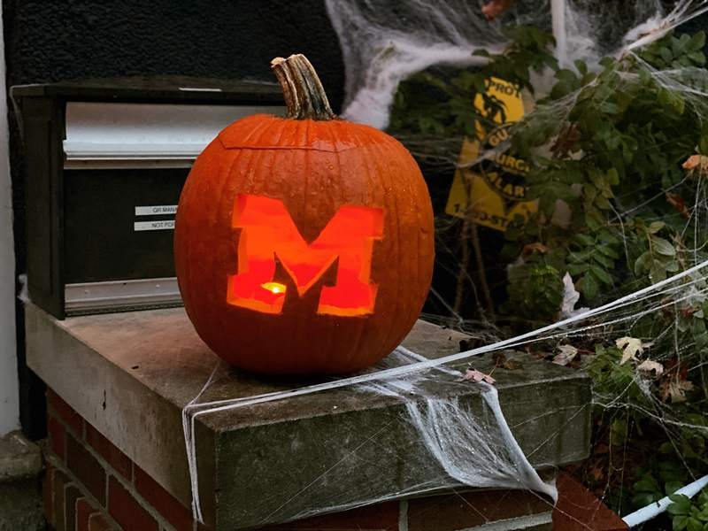 A pumpkin with a Block M carved into it sits on a porch of a home in Burns Park on Oct. 31, 2019.