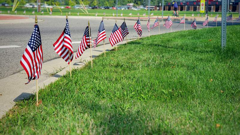 Concordia student volunteers placed the flags along Geddes Rd., Thursday evening Sept. 10, 2020.
