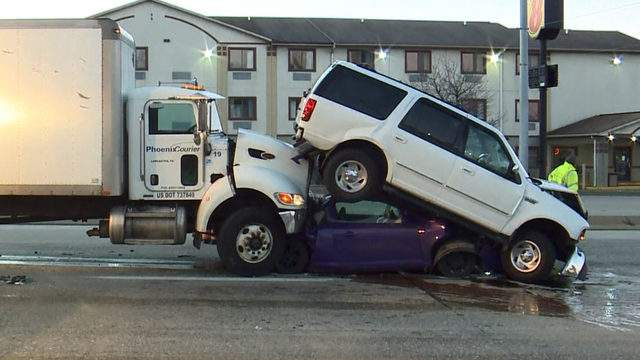 A small car was crushed between a box truck and an SUV Tuesday morning after the truck driver claimed she choked on coffee and blacked out. (WGAL)