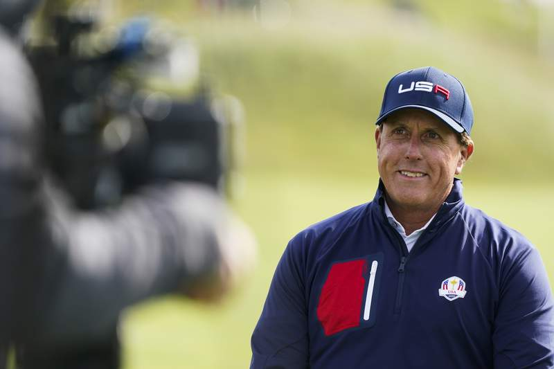 Phil Mickelson smiles during a practice day at the Ryder Cup at the Whistling Straits Golf Course Wednesday, Sept. 22, 2021, in Sheboygan, Wis. (AP Photo/Charlie Neibergall)