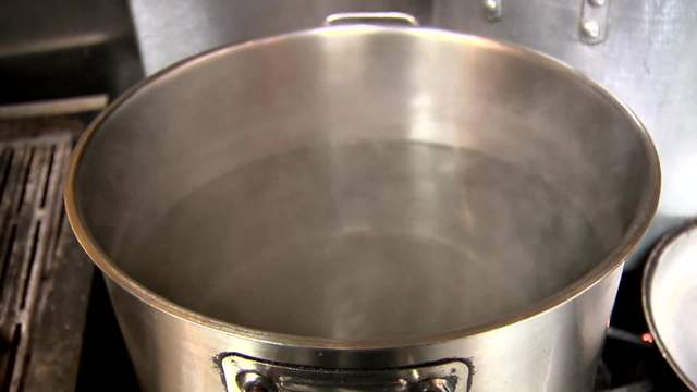 A pot of water prepared to boil.