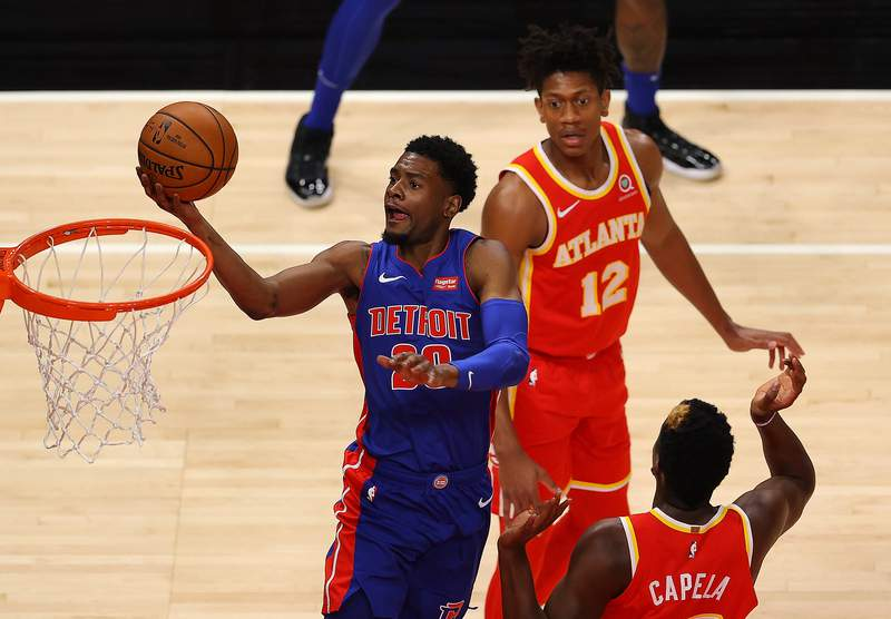 ATLANTA, GEORGIA - DECEMBER 28:  Josh Jackson #20 of the Detroit Pistons drives against Clint Capela #15 of the Atlanta Hawks during the first half at State Farm Arena on December 28, 2020 in Atlanta, Georgia.  (Photo by Kevin C. Cox/Getty Images)