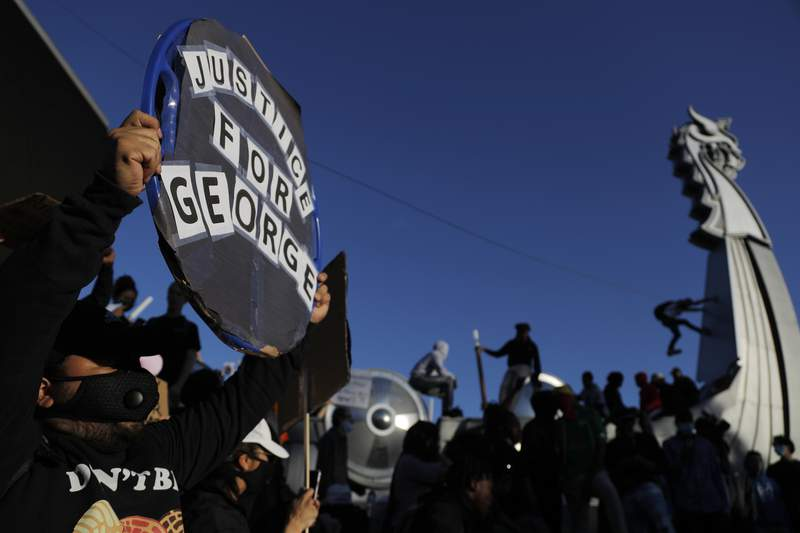 Protesters gather outside the Minnesota Vikings football stadium, Friday, May 29, 2020, in Minneapolis. Protests continued following the death of George Floyd, who died after being restrained by Minneapolis police officers on Memorial Day. (AP Photo/Julio Cortez)