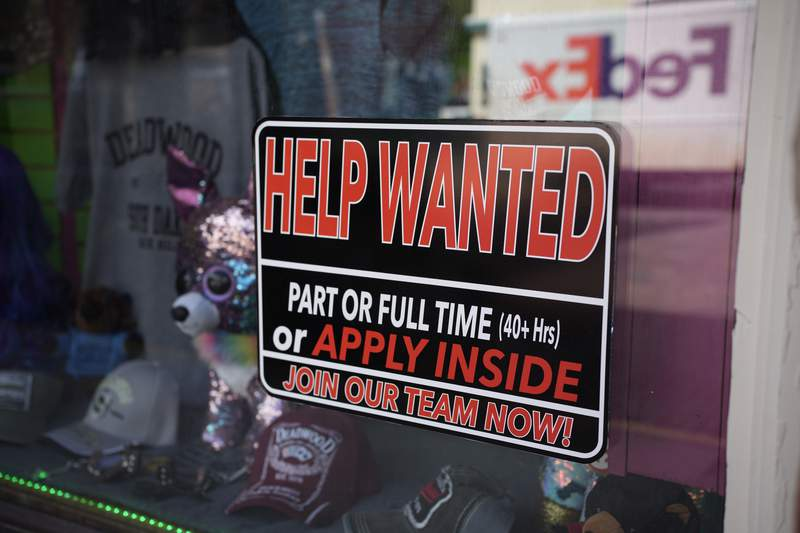 In this May 26, 2021 photo, a sign for workers hangs in the window of a shop along Main Street in Deadwood, S.D. U.S. employers added 559,000 jobs in May, an improvement from Aprils sluggish gain but still evidence that many companies are struggling to find enough workers as the economy rapidly recovers from the pandemic recession.  (AP Photo/David Zalubowski)
