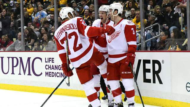 Nick Jensen of the Detroit Red Wings is congratulated by teammates after scoring a goal against the Pittsburgh Penguins at PPG PAINTS Arena on February 19, 2017 in Pittsburgh, Pennsylvania. (Photo by Matt Kincaid/Getty Images)