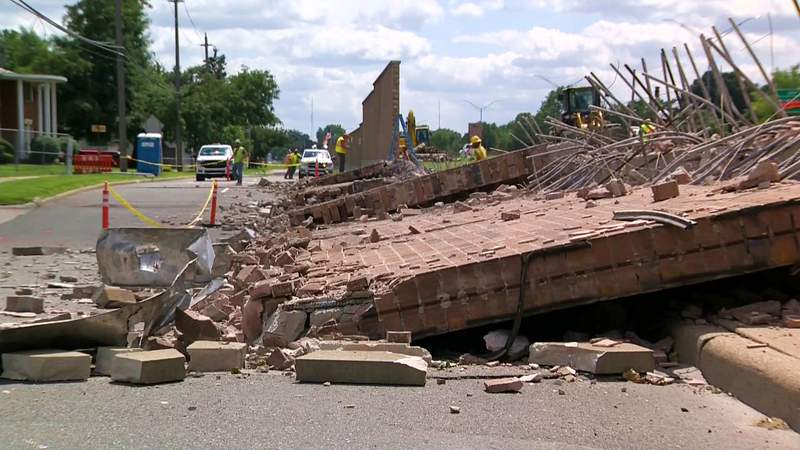 MDOT crews took down a wall between I-75 and the Service Drive that was impacted by a sinkhole.
