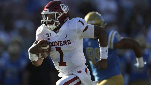 Jalen Hurts #1 of the Oklahoma Sooners breaks free from the pocket on a run during the first half of a game against the UCLA Bruins at the Rose Bowl on September 14, 2019 in Los Angeles, California. (Photo by Sean M. Haffey/Getty Images)