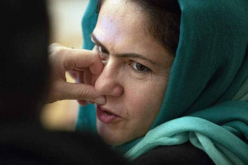 """FILE - In this Feb. 5, 2019, file photo, Afghan politician Fawzia Koofi attends the """"intra-Afghan"""" talks in Moscow, Russia.  Frustrated by a stalled peace process and escalating violence, the U.S. has presented an eight-page draft peace agreement to Afghanistan's warring sides for review. Koofi, one of only four women at the negotiation table in Doha, warned against haste and a May 1 withdrawal of U.S. troops, saying it would cause chaos. She confirmed that all sides had received the U.S.-crafted draft agreement. (AP Photo/Pavel Golovkin, File)"""