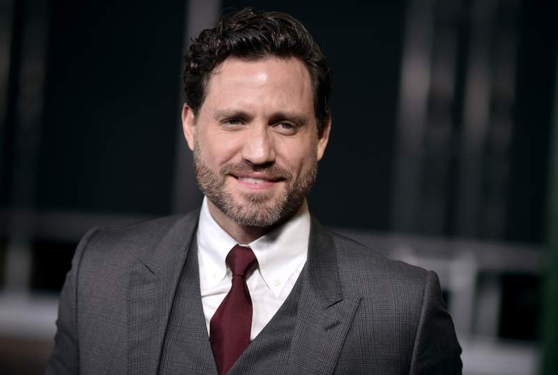 """FILE - Edgar Ramirez arrives at the Los Angeles premiere of """"The Irishman"""" on Thursday, Oct. 24, 2019, at the TCL Chinese Theatre. Ramirez wants people to understand that the fight against COVID-19 is not over. The Venezuelan actor told the Associated Press that his own family is suffering gravely. He tells the AP that he has family members who are dying of COVID-19, and that people must remain vigilant and people should trust science and follow the recommendations and be wary of misinformation. (Photo by Richard Shotwell/Invision/AP, File)"""