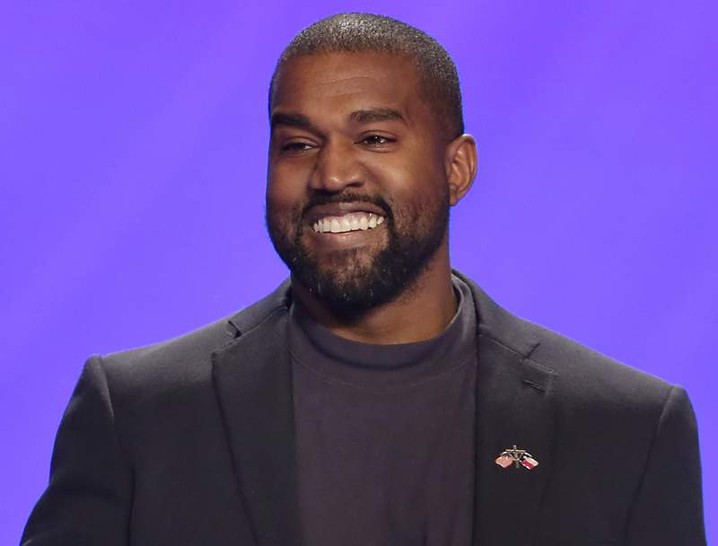 FILE - This Nov. 17, 2019 file photo shows Kanye West on stage during a service at Lakewood Church in Houston.  West has donated $2 million dollars to support the families and legal teams for George Floyd, Ahmaud Arbery and Breonna Taylor. A representative for the rapper confirmed that some of the money donated would fully cover college tuition costs for Floyds 6-year-old daughter, Gianna. Floyd died last month after a Minneapolis police officer pressed his knee on his neck for more than eight minutes as he pleaded for air. (AP Photo/Michael Wyke, File)