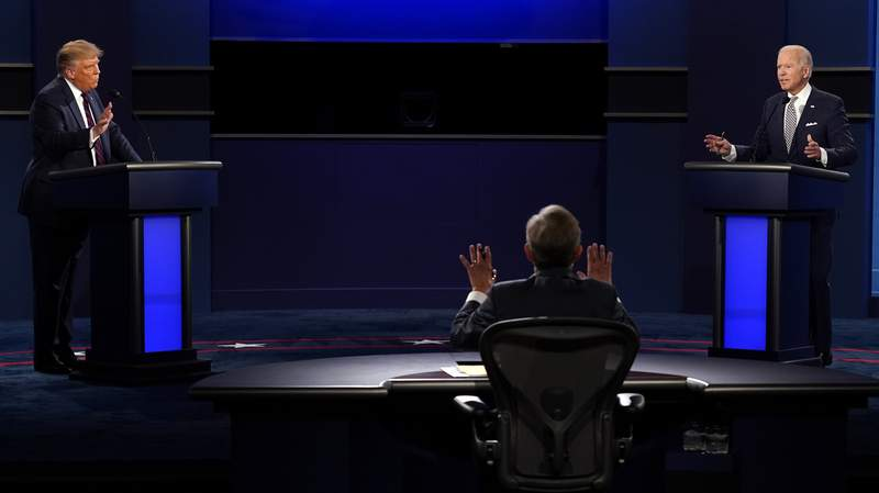 Moderator Chris Wallace of Fox News speaks as President Donald Trump and Democratic candidate former Vice President Joe Biden speak during the first presidential debate Tuesday, Sept. 29, 2020, at Case Western University and Cleveland Clinic, in Cleveland, Ohio.(AP Photo/Patrick Semansky)