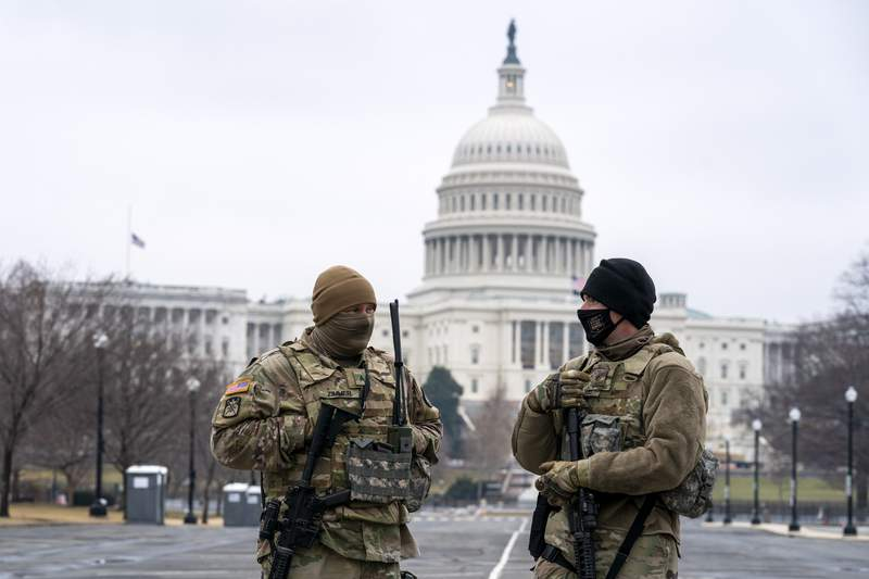 Members of the National Guard patrol the area outside of the U.S. Capitol on the third day of the second impeachment trial of former President Donald Trump, on Capitol Hill in Washington, Thursday, Feb. 11, 2021. (AP Photo/Jose Luis Magana)