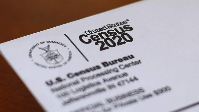 FILE - In this Sunday, April 5, 2020 file photo, An envelope containing a 2020 census letter mailed to a U.S. resident is shown in Detroit. A top lawmaker says the Trump administration is seeking to delay deadlines for the 2020 census because of the coronavirus outbreak. U.S. Rep. Carolyn Maloney said Monday, April 13, 2020 that administration officials also were asking that the timetable for releasing apportionment and redistricting data used to draw congressional and legislative districts be pushed back. (AP Photo/Paul Sancya, File)