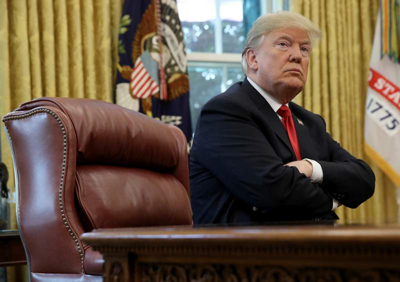 President Donald Trump discusses the potential impact of Hurricane Michael during a meeting with Homeland Security Secretary Kirstjen Nielsen and FEMA Administrator Brock Long in the Oval Office of the White House on October 10, 2018 in Washington, DC. (Photo by Win McNamee/Getty Images)
