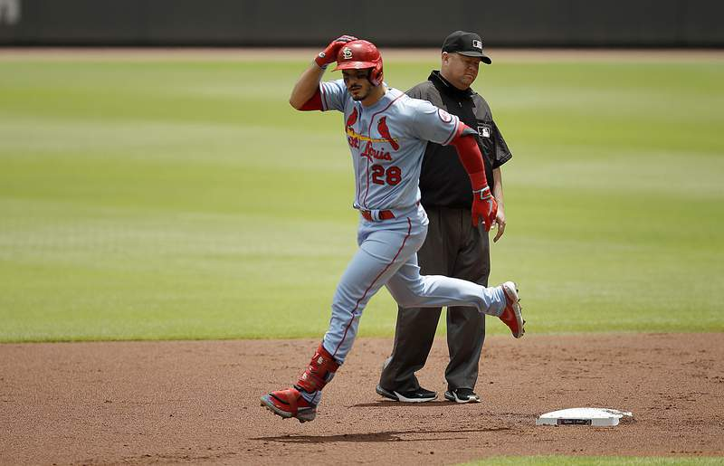 CORRECTS THE DAY AND DATE TO SUNDAY, JUNE 20, NOT SATURDAY, JUNE 19 - St. Louis Cardinals' Nolan Arenado rounds second base after hitting a two-run home run in the first inning of the first baseball game of a double header Sunday, June 20, 2021, in Atlanta. (AP Photo/Ben Margot)