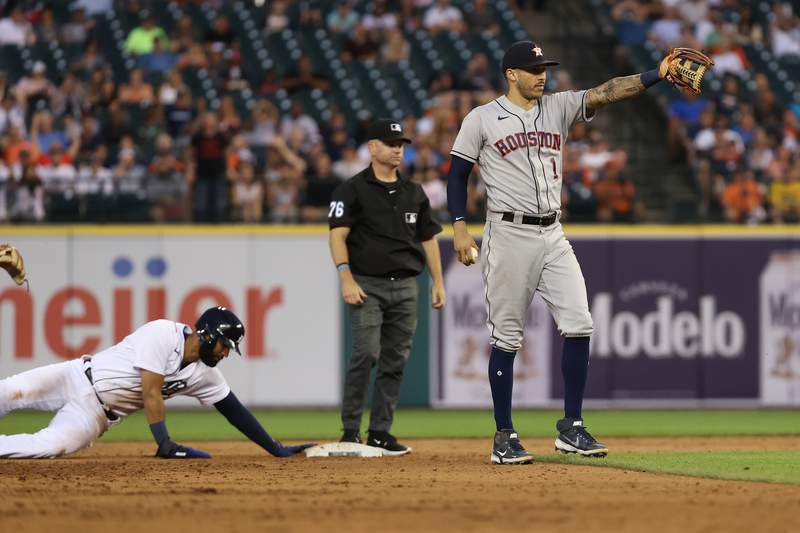 DETROIT, MICHIGAN - JUNE 24: Carlos Correa #1 of the Houston Astros points to home plate after tagging out Nomar Mazara #15 of the Detroit Tigers on a throw from catcher Martin Maldonado at Comerica Park on June 24, 2021 in Detroit, Michigan. (Photo by Gregory Shamus/Getty Images)
