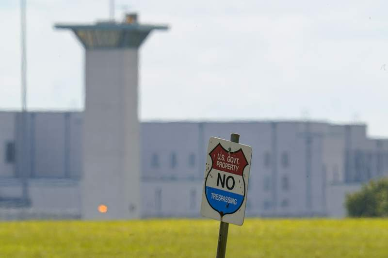 FILE - In this Aug. 26, 2020, file photo, the federal prison complex in Terre Haute, Ind. All federal prisons in the United States have been placed on lockdown, with officials aiming to quell any potential violence that could arise behind bars as law enforcement prepares for potentially violent protests across the country in the run-up to President-elect Joe Biden's inauguration on Wednesday. (AP Photo/Michael Conroy, File)