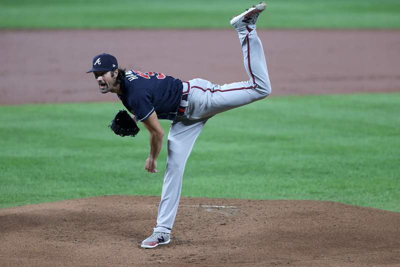Starting pitcher Cole Hamels #32 of the Atlanta Braves throws to a Baltimore Orioles batter in the first inning at Oriole Park at Camden Yards on September 16, 2020 in Baltimore, Maryland.