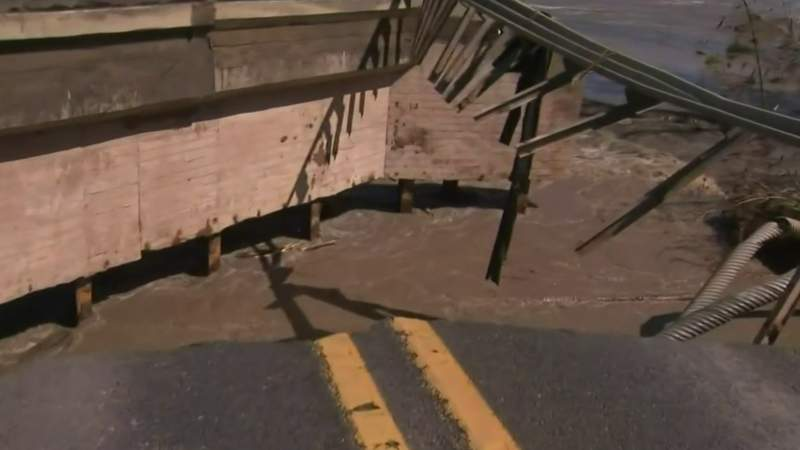 Flooding: Raging waters take out bridge in Edenville